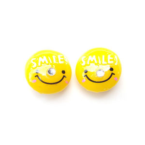 "Round, yellow ""SMILE"" Clip-ons"